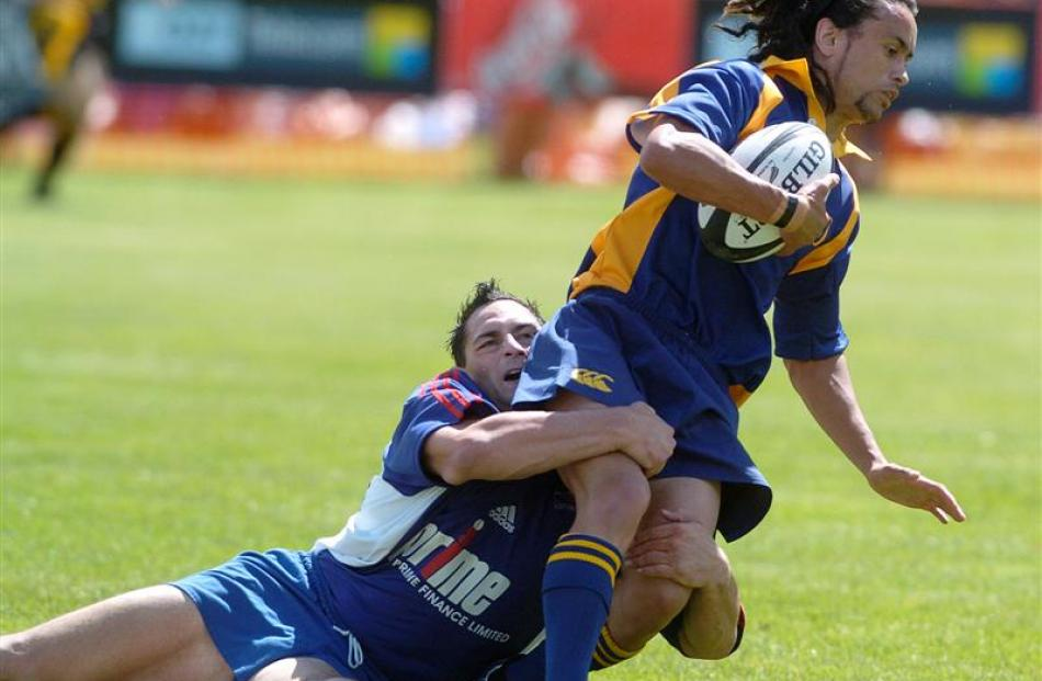 Otago's Andrew Tuaine is tackled by Horowhenua-Kapiti's Danny Feehan in 2005.