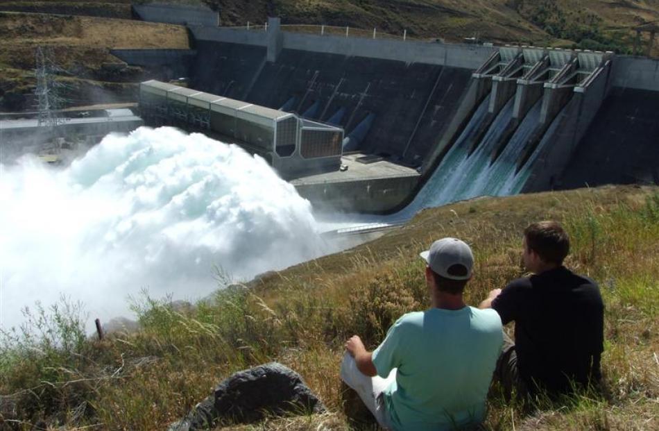Chris Quinn, of Alexandra (left), and Neil Simmons, of Invercargill, watch the Clyde Dam spilling...