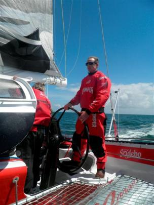 Stu McLachlan takes the helm of Sodebo, a 105-foot racing trimaran, off the coast of Lorient,...