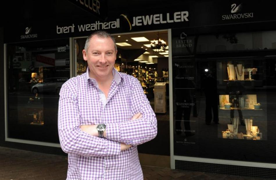 Brent Weatherall outside his George St store. Photo by Craig Baxter.