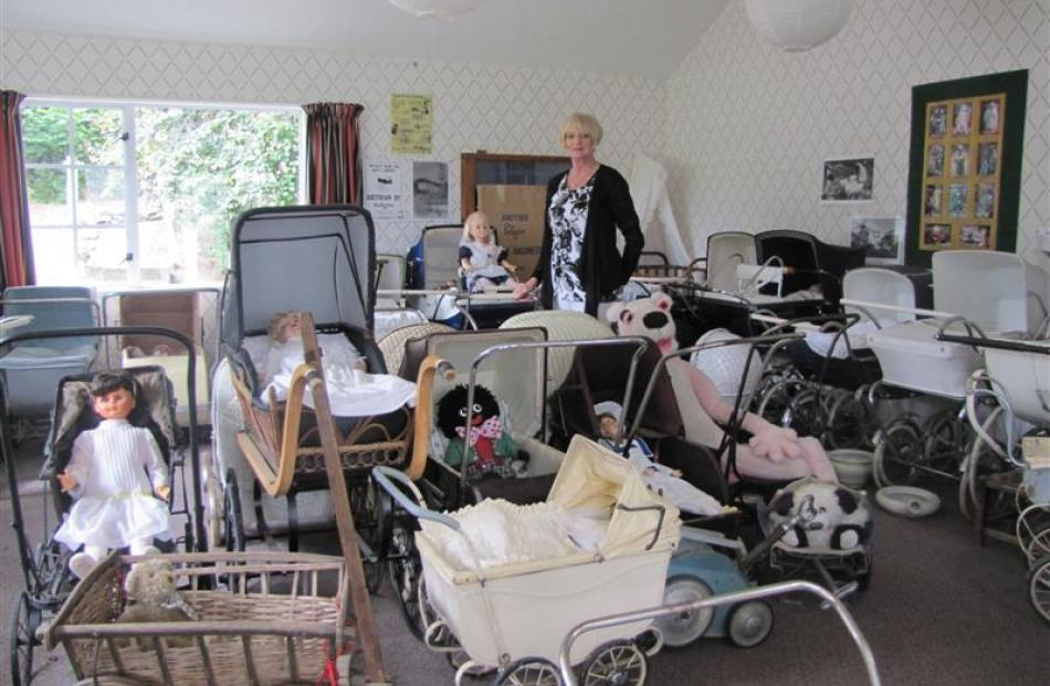 Shingle Creek pram collector Lesley McGregor with some of her 60 prams which date back to the...