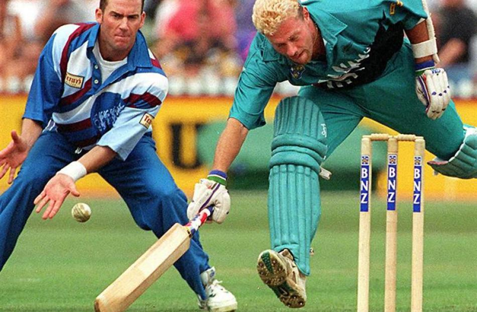 Heath Davis narrowly makes his ground during a one-day match against England in 1997.