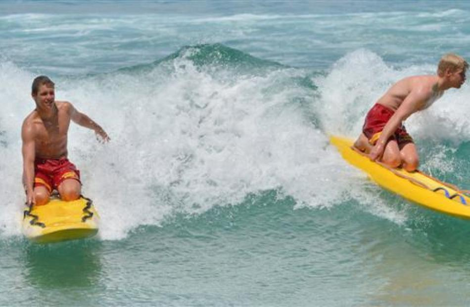 St Clair Surf Life Saving Club lifeguards Angus MacKenzie (left) and Andrew Trembath enjoy  the...