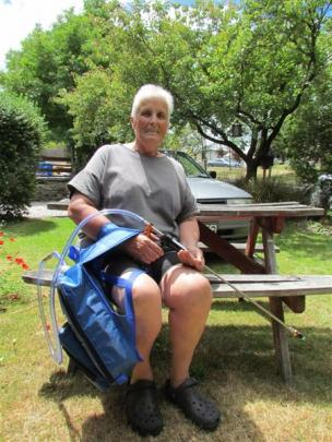 Wilding pines volunteer Fran O'Connor with one of the new basal barking backpacks with which ...