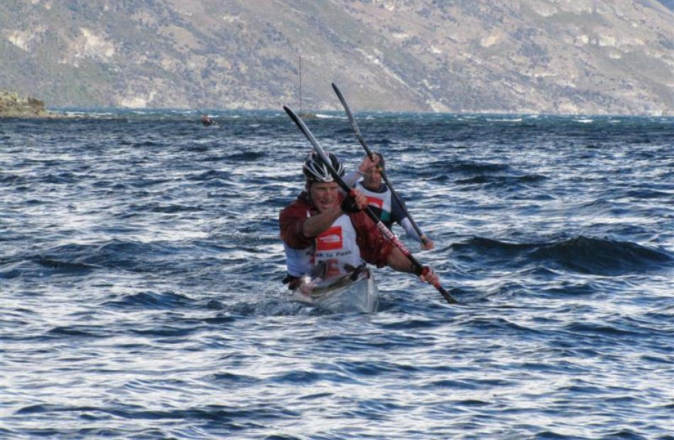 Paddling in Queenstown Bay in rough conditions in the Peak2Peak multisport race in 2011. Photo by...