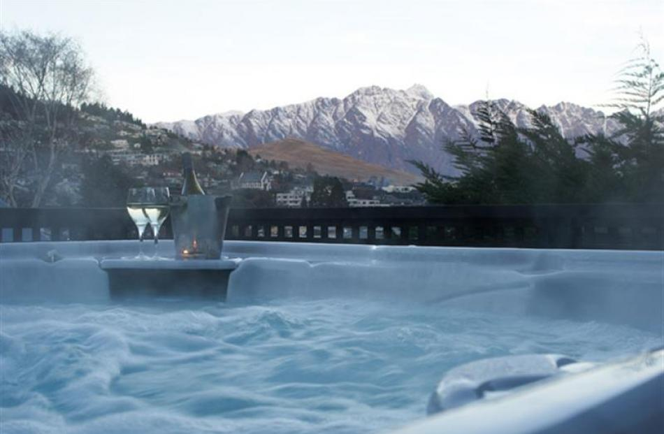 The outdoor spa pool has a view of the Remarkables. Photos supplied.