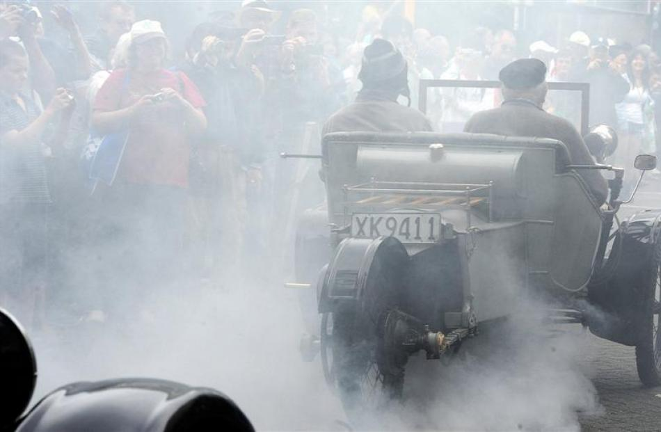 Stuart McCraw's 1911 AC Sociable two-seater says a smoky goodbye