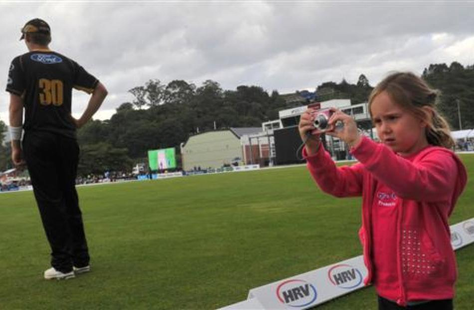 Maddi McBride (5), of Dunedin, captures the moment beside Wellington cricketer Harry Boam.