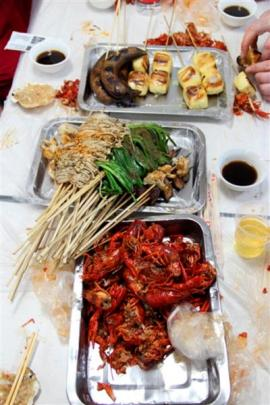 Crawfish and a selection of other Chinese food at the start of a new crawfish season.