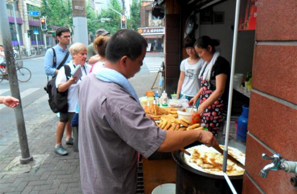 Eating breakfast in Shanghai.Photos by Dene MacKenzie.