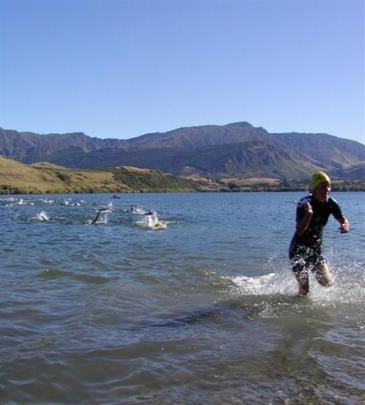 Swimmers compete in  last year's Lake Hayes triathlon.