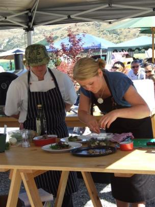 Naomi Lindsay perfects her dish, watched by mentor chef Jenny Stewart.