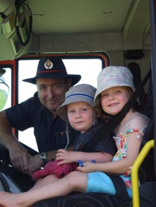 Southern Region Fire Safety Officer Stuart Ide shows Eddie  (2) and Ava (3)  Stewart,  of...