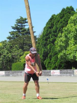 Wayne Doyle, of  Timaru prepares to toss the caber. Photos by Andrew Ashton.