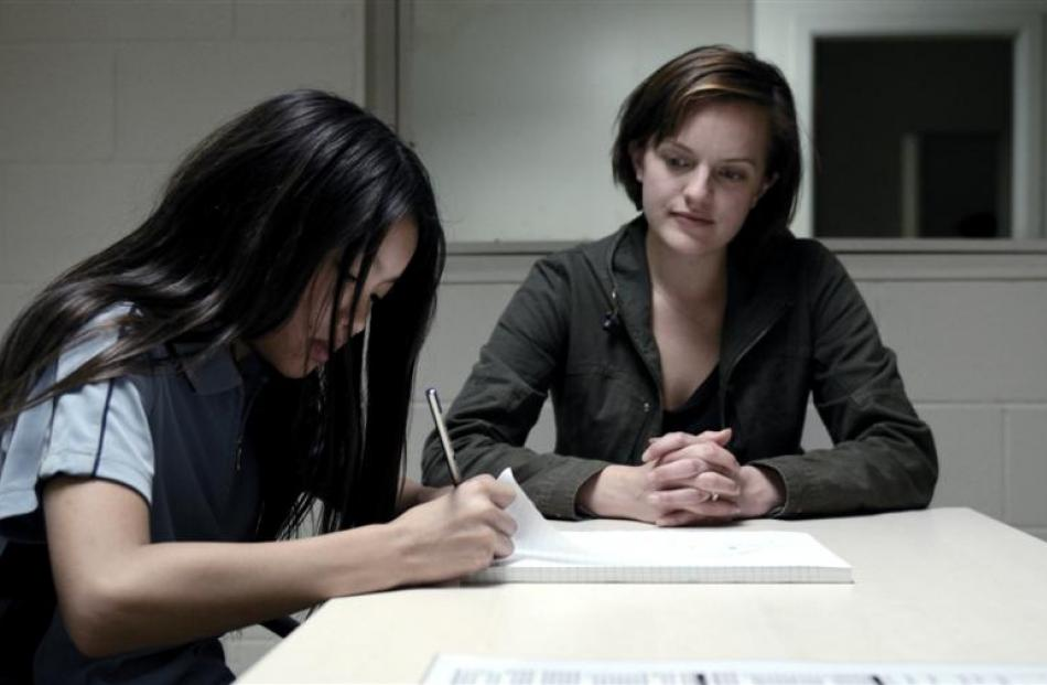 Young Tui Mitcham (newcomer Jacqueline Joe), daughter of a drug lord, is interviewed by detective...