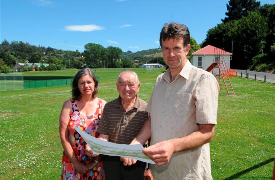 Kerry Goodhew (right), wife Elizabeth and neighbour Ron Chapman examine plans for new buildings...