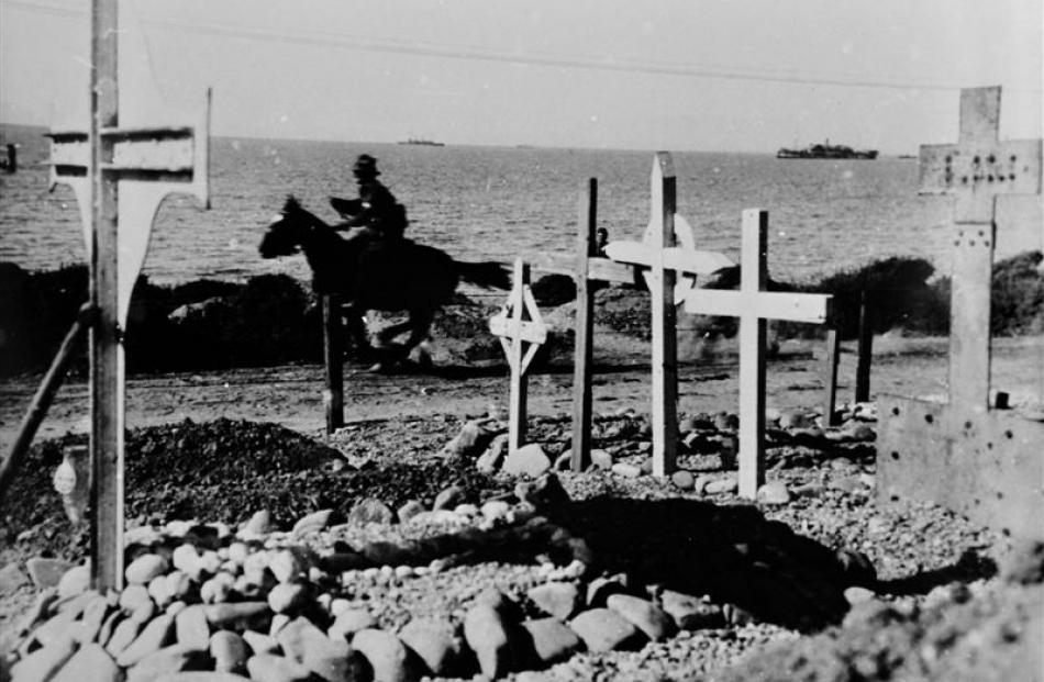 A horseman passes a Gallipoli cemetery. Photos from Hocken Collections, Uare Taoka O Hakena,...