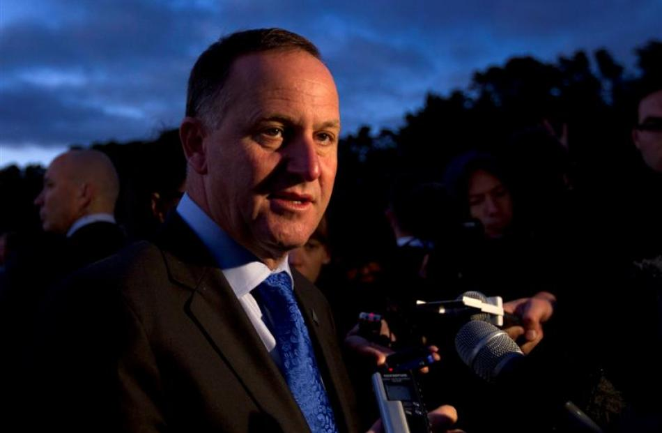 Prime Minister John Key speaks  to the media on the Treaty Grounds at Waitangi after the dawn...
