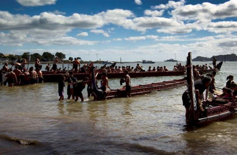 Performers boarding their waka in the Bay of Islands during Waitangi Day celebrations yesterday. ...