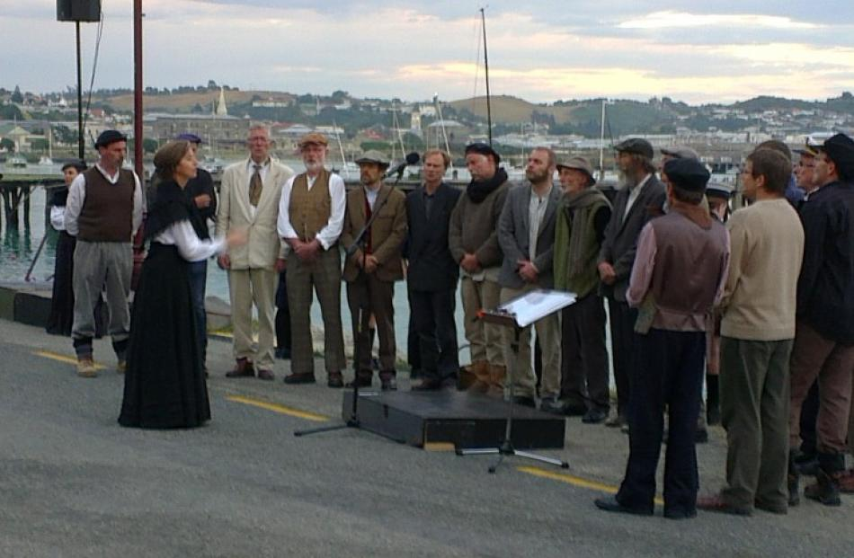A choir performs during the re-enactment.