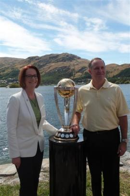 Australian Prime Minister Julia Gillard and  New Zealand Prime Minister John Key  pose with the...