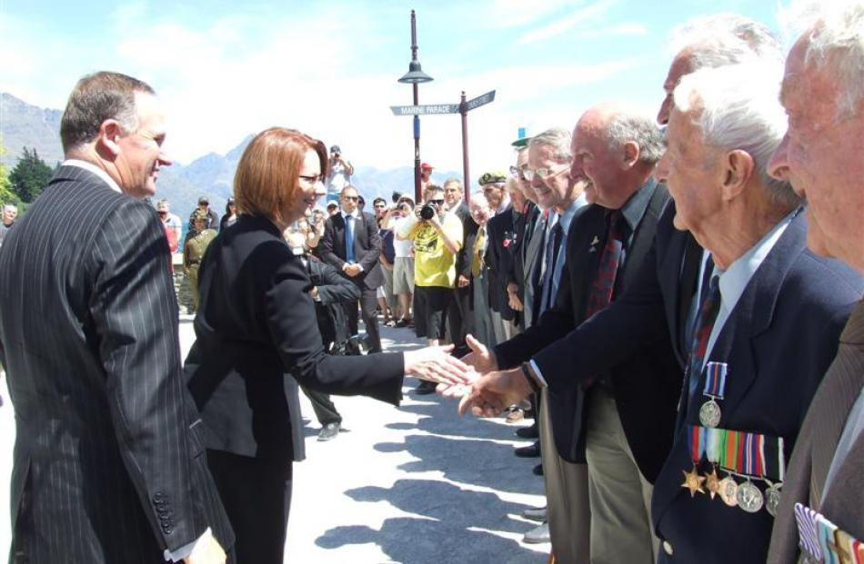 Both Prime Ministers shook hands with the returned services and war veterans at Queenstown's war...