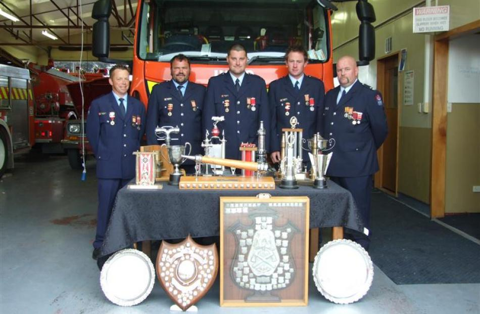 The Balclutha team (left) with their haul of 19 trophies won at the Otago-Southland fire brigades...