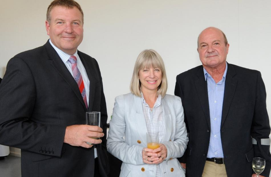 Otago Daily Times Editor Murray Kirkness, with Ann and John Scandrett.