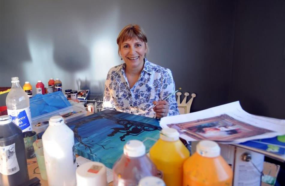 Dunedin artist Lauren Bremner (53) at work. Photo by Peter McIntosh.