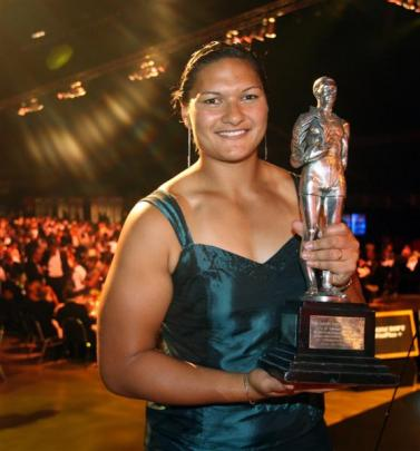 Shot putter Valerie Adams holds the trophy she received in 2008, the year she won gold at the...