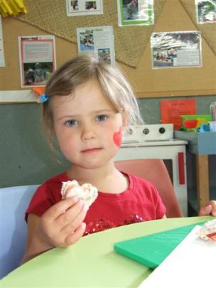 Jessie Glover (4) shows a freshly made heart-shaped sandwich.