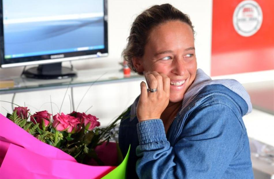 Arai Te Uru Whare Hauora health adviser Tash Mattingly  gets a dozen blooms at her workplace.