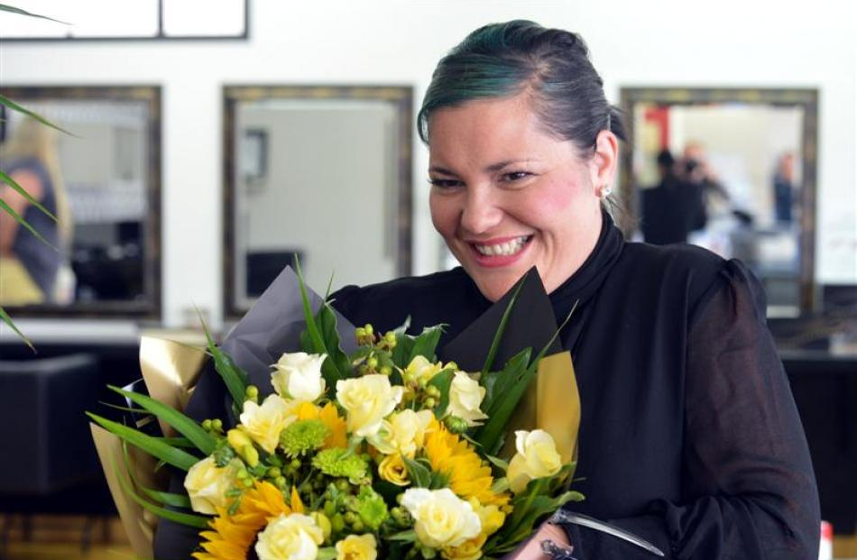 Configure Express Dunedin hairdresser Tania Stewart  gets flowers from her husband.