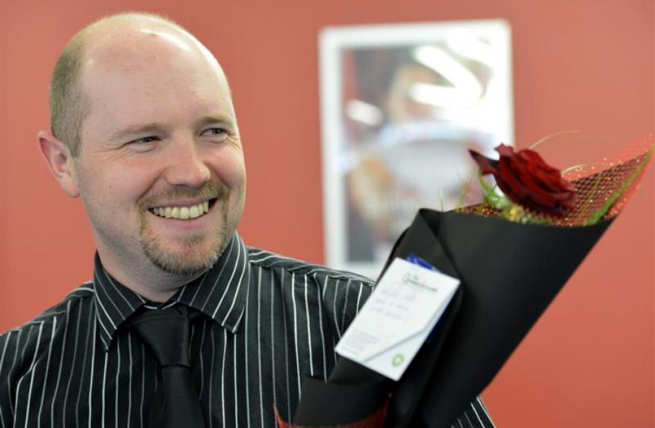Work and Income staff member Hayden Mills with his Valentine's Day gift.