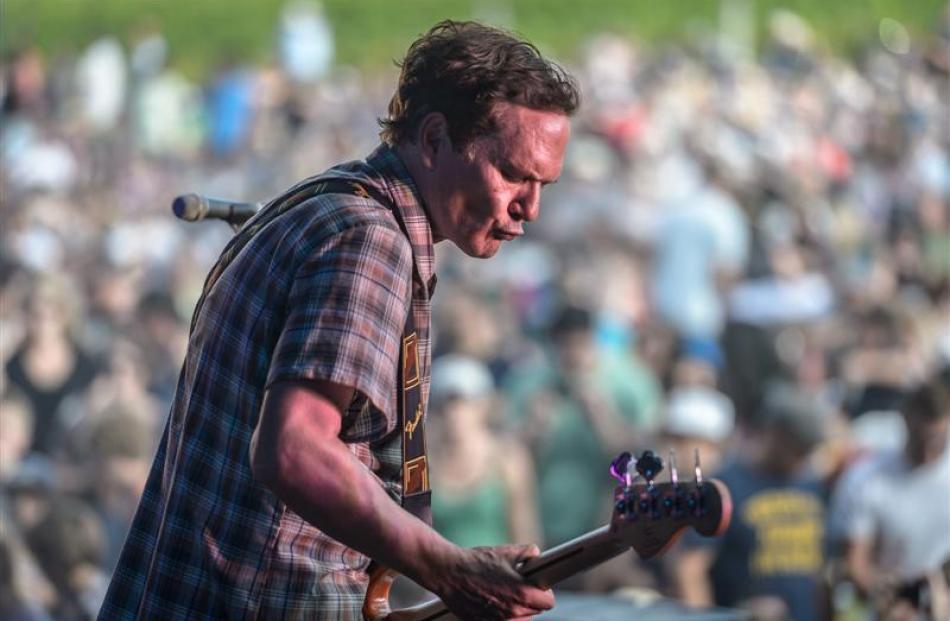 Shayne Carter plays to the crowd at Matakana. Photo by Steve Dykes.
