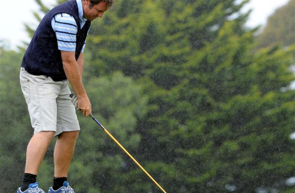 James Reid plays his tee shot on the first hole.