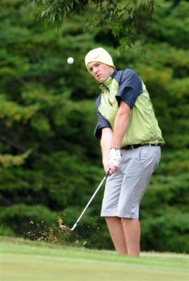 North Otago's Michael Ormandy plays a shot on to the No 3 green.