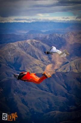 Mr Aitchison during a wingsuit flight over Pudding Hill, Methven; and while being filmed by...