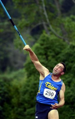 Michael Scholten (Taieri) on his way to winning the men's 20-34 javelin title during the Otago...