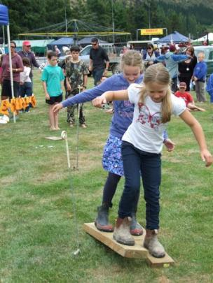 Neleah Manderson  (9, front) and Annabelle Toms (8),  of Roxburgh, teamed  for the agri-sports ...