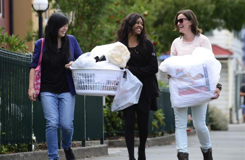 First-year University of Otago students (from left) Cindy Cheakhun (17), of Wellington, Manisha...