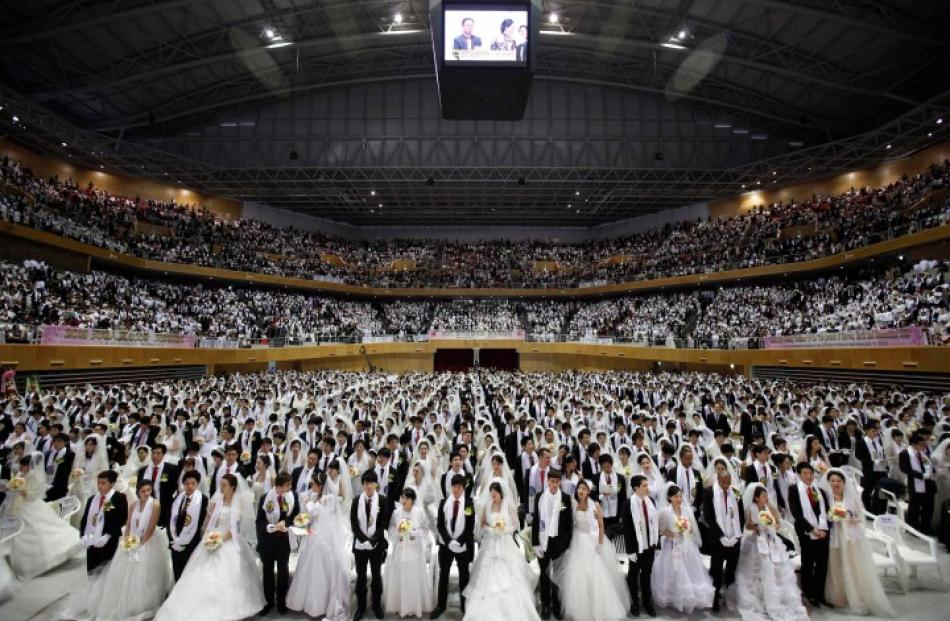 Thousands of newlyweds took part in the ceremony.REUTERS/Kim Hong-Ji