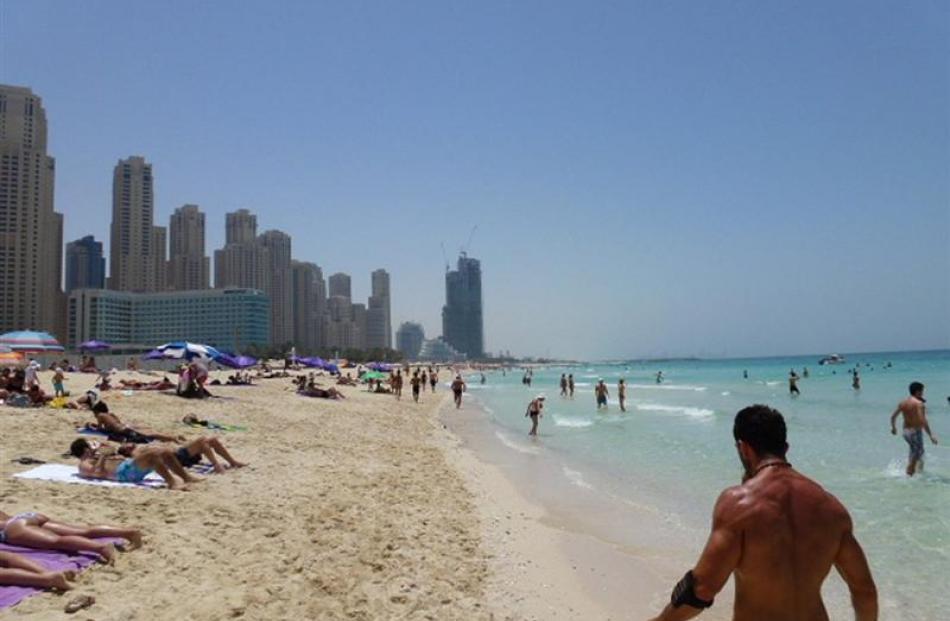 Sun-seekers populate Jemeirah Beach. Photo by Neville Peat.