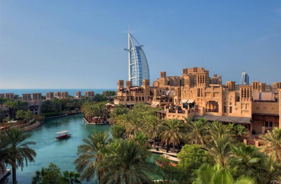 The luxury Burj al Arab Hotel commands views of the sea and a man-made waterway. Photo by Dubai...