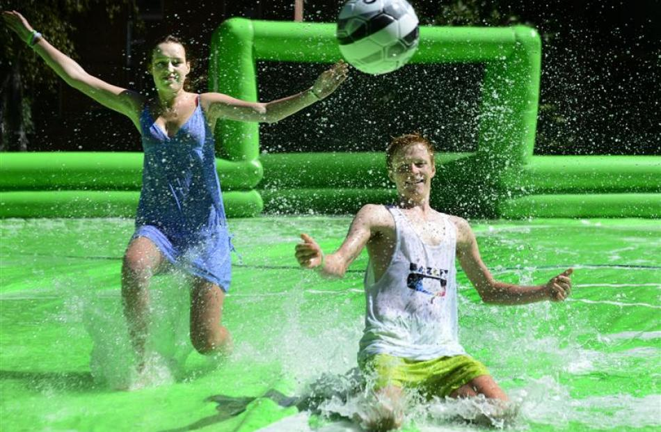 Enjoying a splash at tent city on the museum lawn are Alex Blennerhassett (17), of Christchurch ...