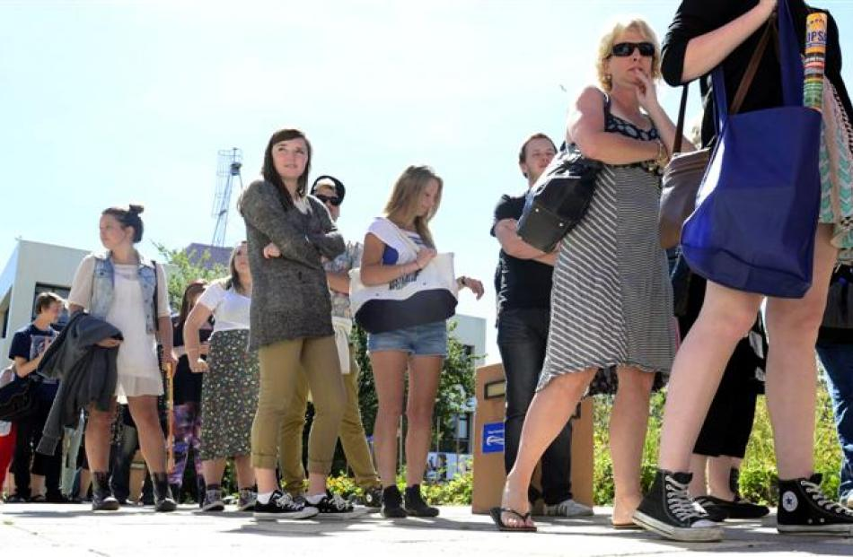 Students line up for  free food at a barbecue at Otago Polytechnic.  Photo by Peter McIntosh.