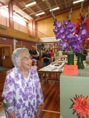 Cassie Weir, of Ranfurly, admires the flower entries at the Maniototo A&P Show yesterday.