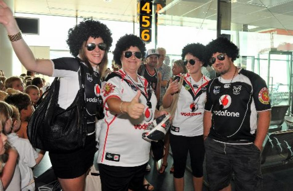 Warriors supporters (from left) Rachel Kemp (26), Jenna Heron (26), Maria Dudley (25) and Anthony...
