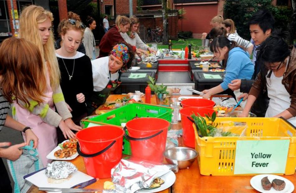 Competitors rush to complete their dishes in the Otago Farmers Market Masterchef Competition...