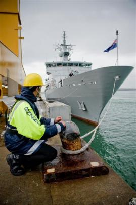 Where's the crew? HMNZS Wellington berths at Devonport Naval Base. Photos from NZ Herald.